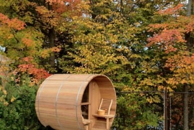 exterior picture of toule 4 person barrel sauna with porch seats