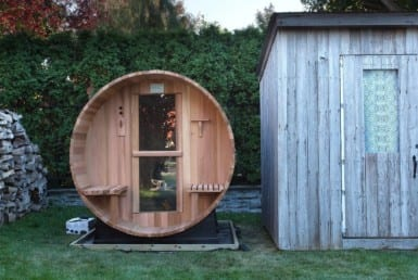 outdoor sauna next to shed