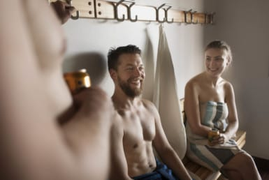 Group enjoying community sauna benefits
